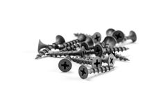 Metal screws. Black metal screws isolated on white background Royalty Free Stock Images