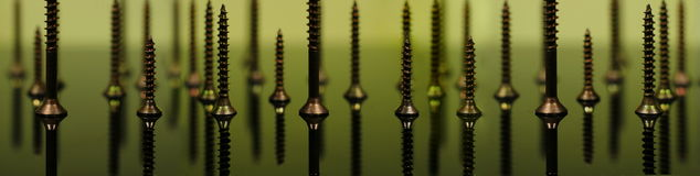 Metal screws macro photo - background Royalty Free Stock Image