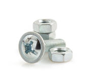 Metal screws and nut tool on white Royalty Free Stock Photography