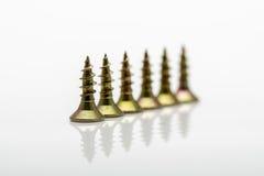 Metal screws. Metal screws tool on white background royalty free stock photo