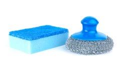 Metal scrub and blue sponge Royalty Free Stock Photo