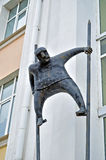 Metal sculpture of man on stilts made in modern style at the facade of Novgorod center of contemporary art in Veliky Novgorod, Rus. VELIKY NOVGOROD, RUSSIA Royalty Free Stock Photos