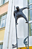 Metal sculpture of man on stilts made in modern style at the facade of Novgorod center of contemporary art in Veliky Novgorod, Rus Stock Photos