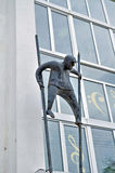 Metal sculpture of man on stilts made in modern style at the facade of Novgorod center of contemporary art in Veliky Novgorod, Rus. VELIKY NOVGOROD, RUSSIA Royalty Free Stock Images
