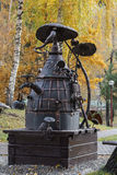 Metal sculpture of the moonshine still. In city park royalty free stock photography