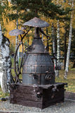 Metal sculpture of the moonshine still. In city park stock photos