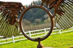 Metal Sculpture in Vineyard. Metal Winged Sculpture in Sonoma Valley, California Royalty Free Stock Image