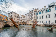 Metal sculptures in water canal of Treviso Stock Photo