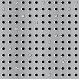 Metal seamless background with perforation Stock Photos