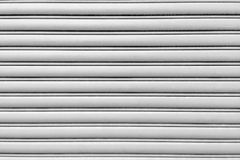 Metal security roller door background Stock Images