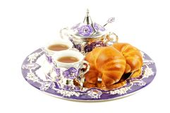 Metal set for tea and croissant Royalty Free Stock Photo