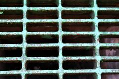 Metal sewer grate for the collection of water Royalty Free Stock Images
