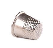 Metal sewing thimble. Isolated on a white background Stock Photography
