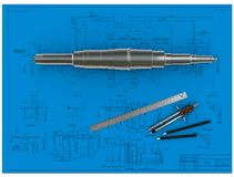 Metal shaft, compasses, rulers and pencils at an e Royalty Free Stock Photo