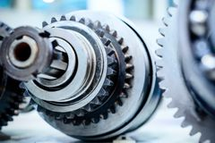 Metal shaft with gears and spline teeth. Stock Images