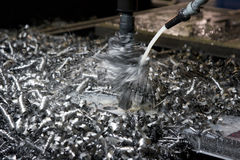 Metal shavings. During drilling an aperture and sparks of a cooling liquid Royalty Free Stock Images