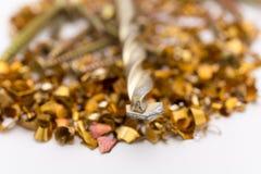 Metal shavings and screws Royalty Free Stock Images