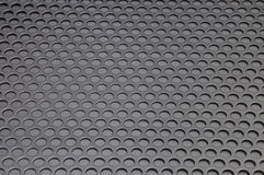 Metal sheet. Surface with holes stock photo