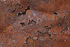 The metal sheet covered with corrosion. The metal sheet is coated with corrosion holes Royalty Free Stock Photography