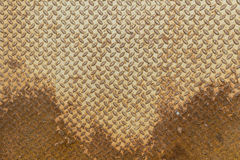 Metal sheet diamond plate floor material with rust Stock Photo