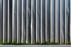 Metal sheet fence enclosed around the construction site. The construction site border fance enclosed high and strong by corrugate metal sheet Royalty Free Stock Image