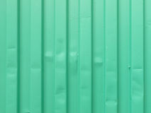 Metal sheet in green paint background Stock Image