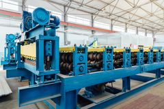 Metal sheet profiling factory. New modern roll forming machine.  royalty free stock photography