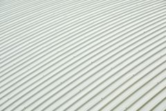 Metal sheet roof curve building. Orderly pattern of roofing metalsheet, large buildings royalty free stock photography