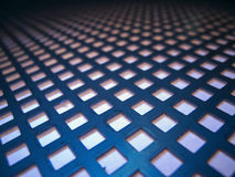 Metal sheet with square holes Stock Images