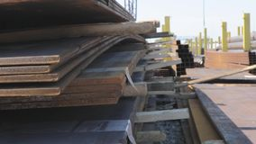 Metal sheets on a metal skala under the open sky, good weather, metal sheets with a gantry crane in the background, a. Metal sheets on a metal skala under the stock video