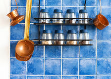 Metal shelf,  spices, kitchenware tools. Kitchen utensils and accessories Royalty Free Stock Photos