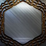 Metal shiel with ornament on old wooden background . Vintage collection Stock Images