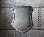 Metal shield over armor plates background Royalty Free Stock Photography