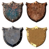 4 Metal Shields Royalty Free Stock Photography