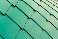 Metal shingles on the roof in the form of diamonds going to overlap. Metal sheets are flat, painted green. Royalty Free Stock Photos