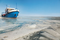 Metal ship in ice Royalty Free Stock Images