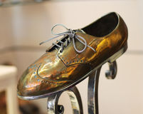 Metal shoes. Great metal shoes in the shop window Royalty Free Stock Photo