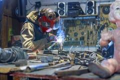 Metal shop welding in progress young worker welding metal rods stock photos