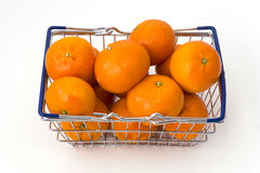 Metal shopping basket filled with clementines Royalty Free Stock Image