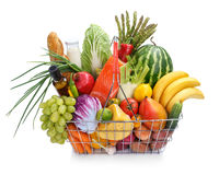 Metal shopping basket with foods Royalty Free Stock Photos