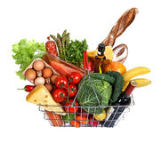 Metal shopping basket with foods. Studio photography of steel wire supermarket shopping carts basket with foodstuff - on white background Royalty Free Stock Image