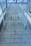 Metal Shopping cart on escalator Royalty Free Stock Photos