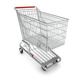 Metal shopping cart for purchase with red handle Royalty Free Stock Photos