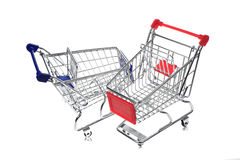 Metal shopping cart on white background Royalty Free Stock Photography
