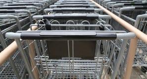 Metal shopping carts in a row Stock Photos
