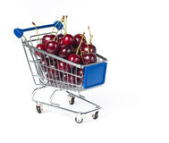 Metal shopping trolley. Filled with cherry Stock Photos