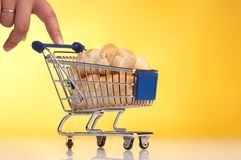 Metal shopping trolley filled with bread Stock Photography