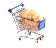 Metal shopping trolley filled with bread Royalty Free Stock Photography