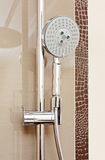 Metal shower tap in modern bathroom Royalty Free Stock Image