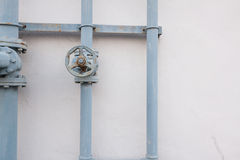 A metal shutoff valve attached to a metal pipe with bolts Royalty Free Stock Photo